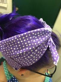purple polka dot do-rag tied around a simple do.